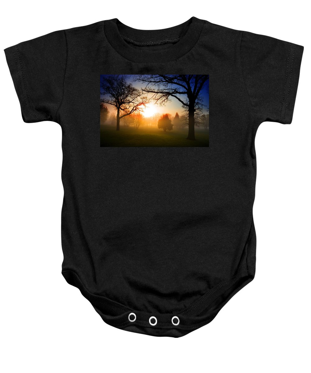 Sunrise Baby Onesie featuring the photograph Sunrise Through Trees by Donald Erickson