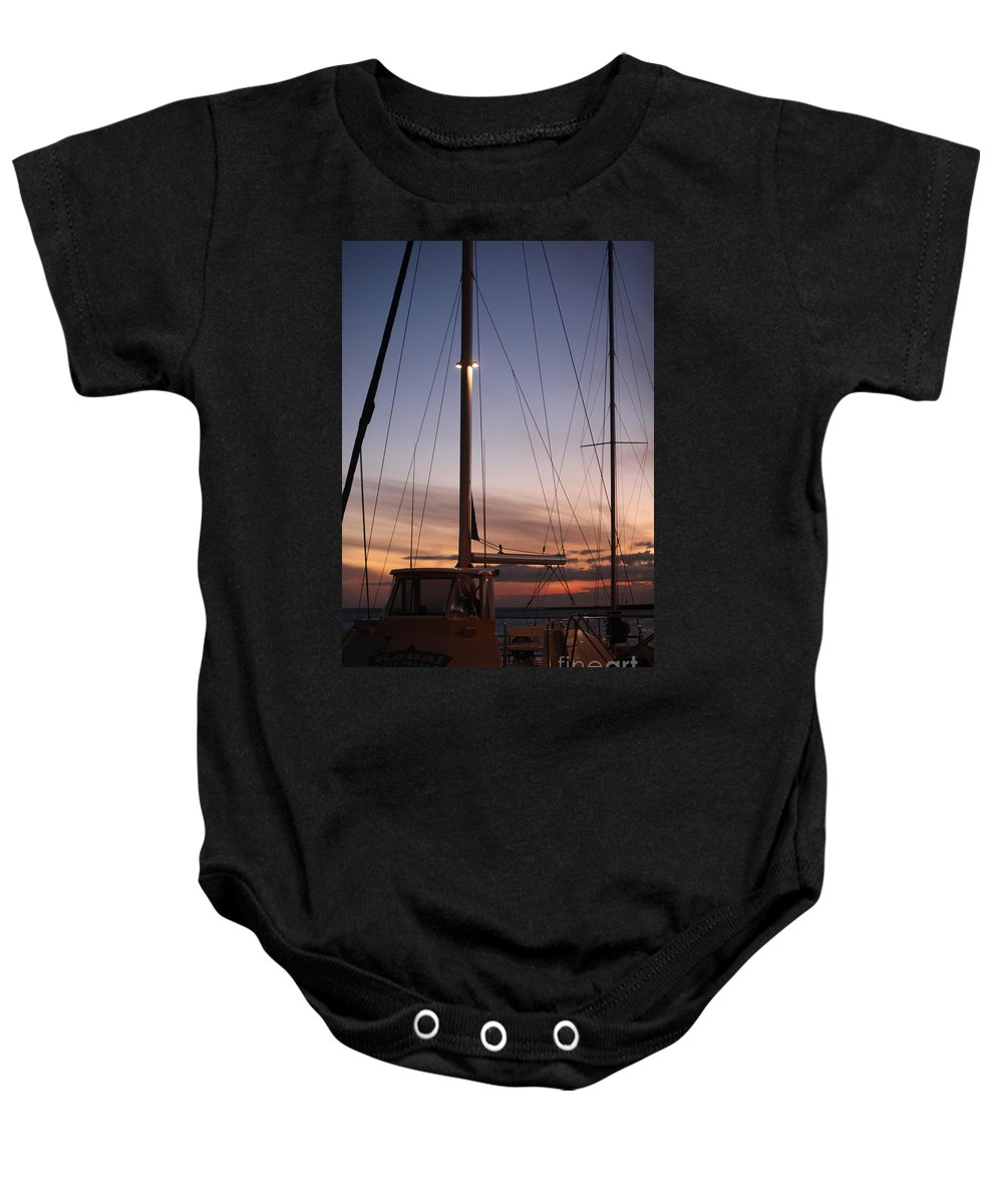 Sunset Baby Onesie featuring the photograph Sunset And Sailboat by Nadine Rippelmeyer