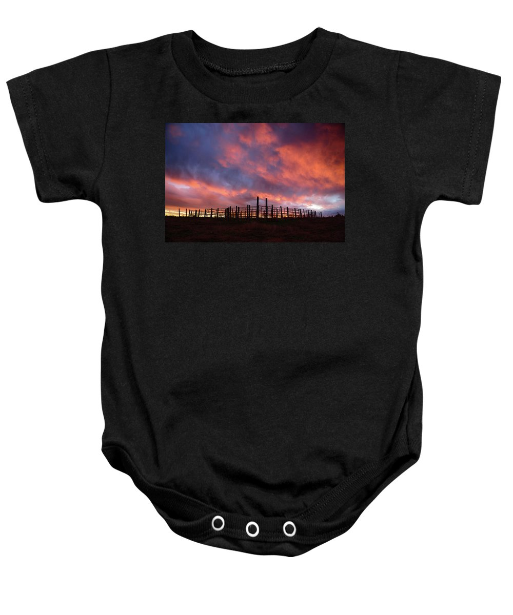 Sunset Baby Onesie featuring the photograph Sunset Corral by Paul Moore