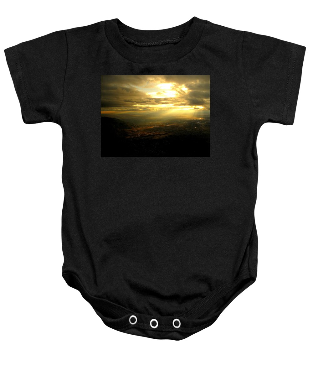 Sunset Baby Onesie featuring the photograph Sunset Over Sandia Mountain by Debbie Karnes