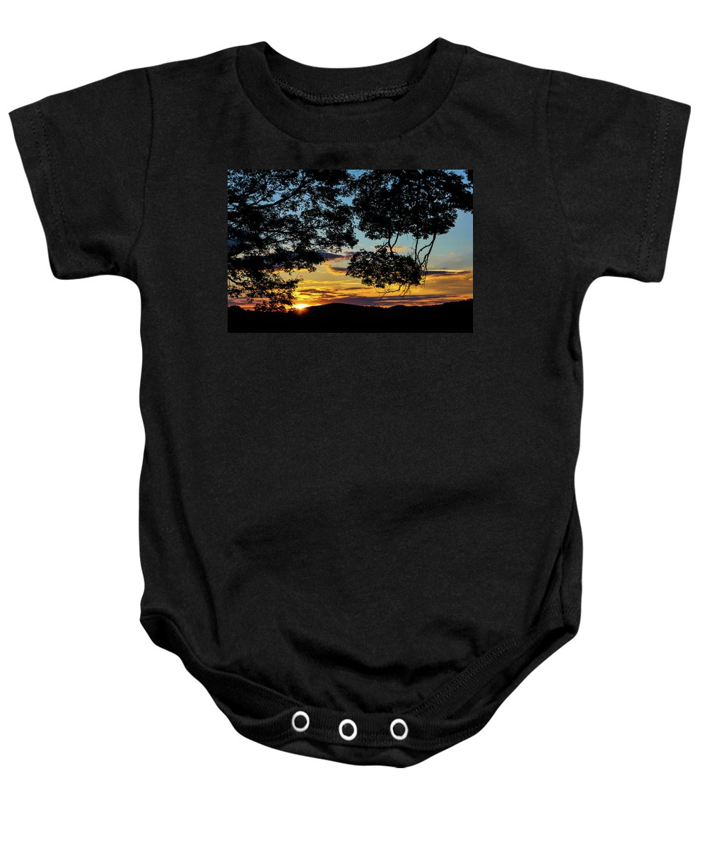 Sunset Baby Onesie featuring the photograph Sunset Through The Trees by Rafael Soares