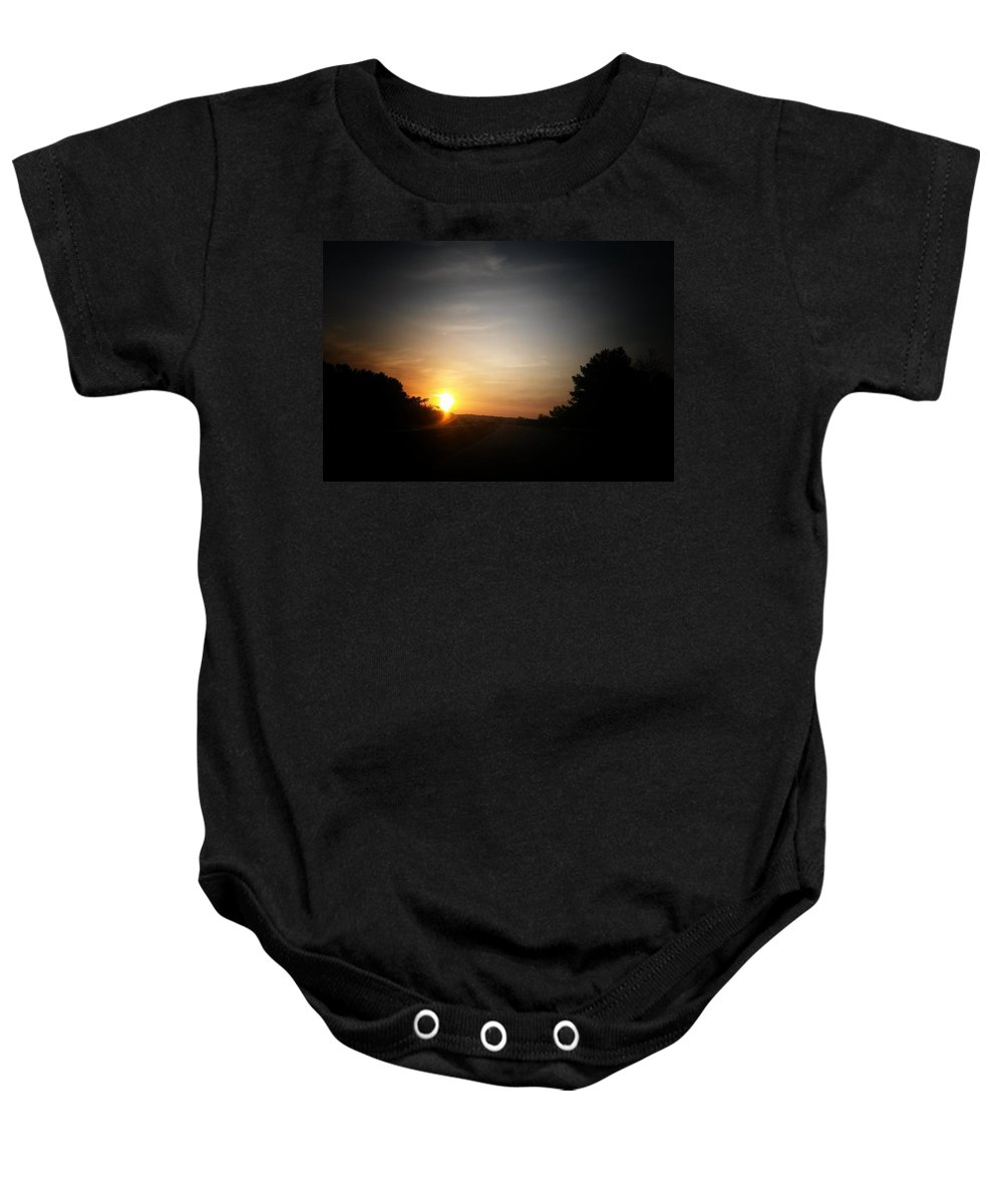 Swirling Sunrise Baby Onesie featuring the photograph Swirling Sunrise by Maria Urso