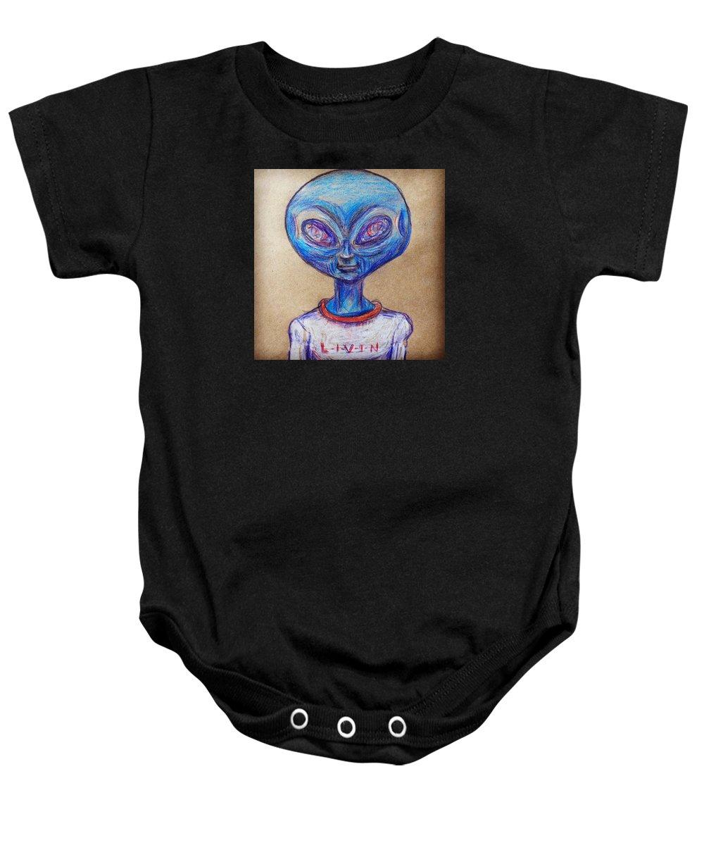 The Alien Is L-i-v-i-n Baby Onesie