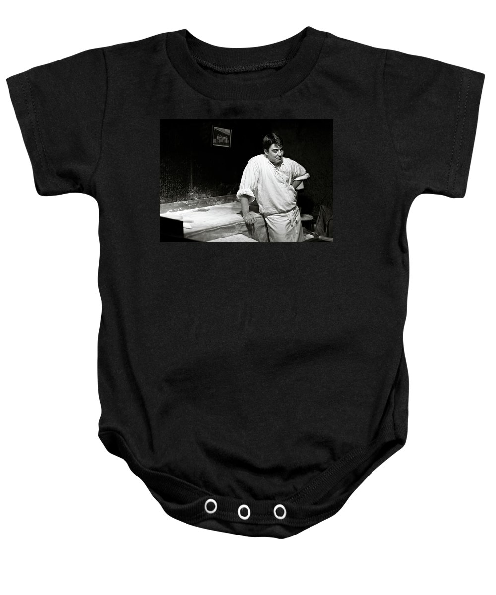 Baker Baby Onesie featuring the photograph The Baker by Dave Bowman
