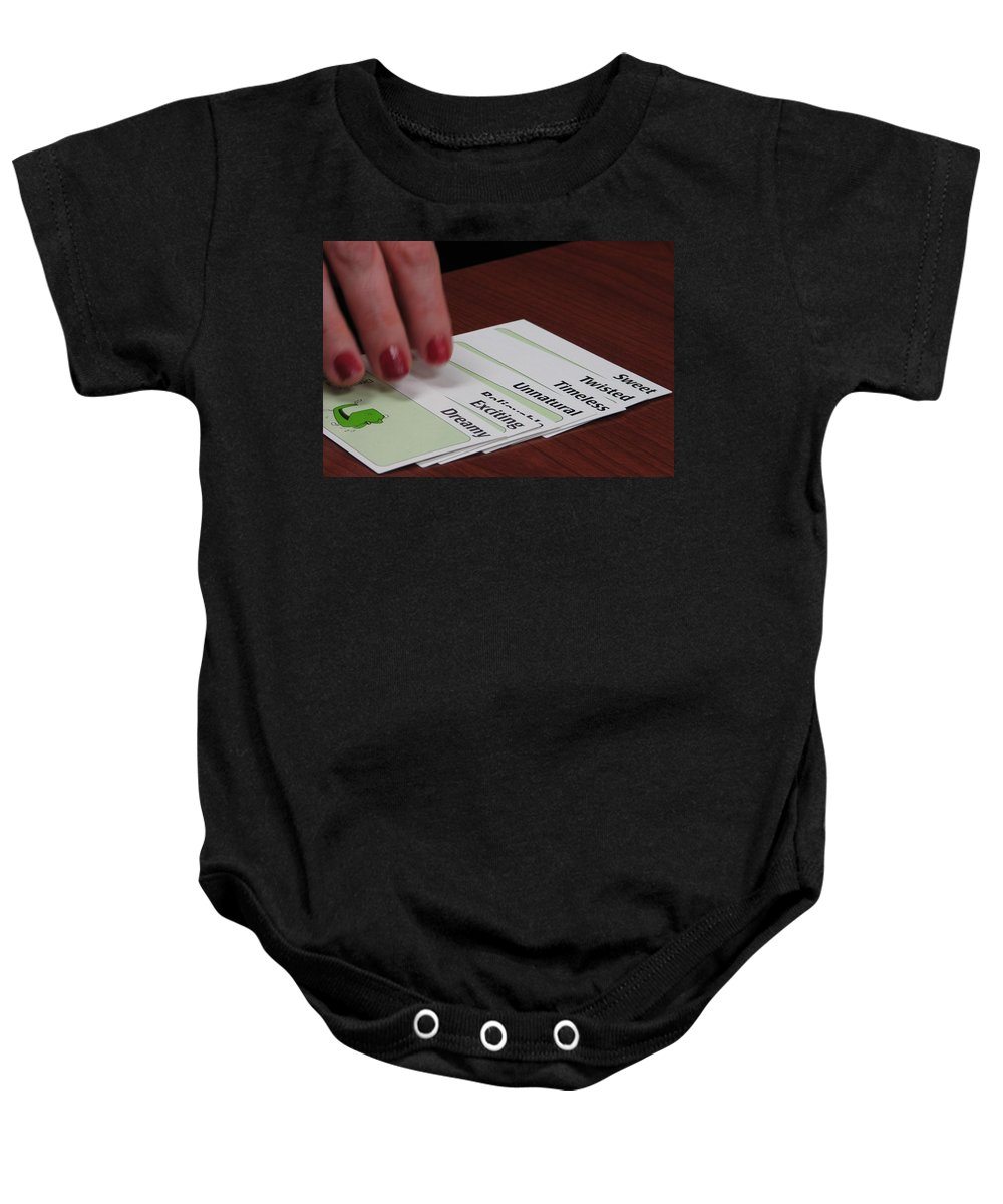 Apples To Apples Baby Onesie featuring the photograph The Cards Don't Lie by Kelly Mezzapelle