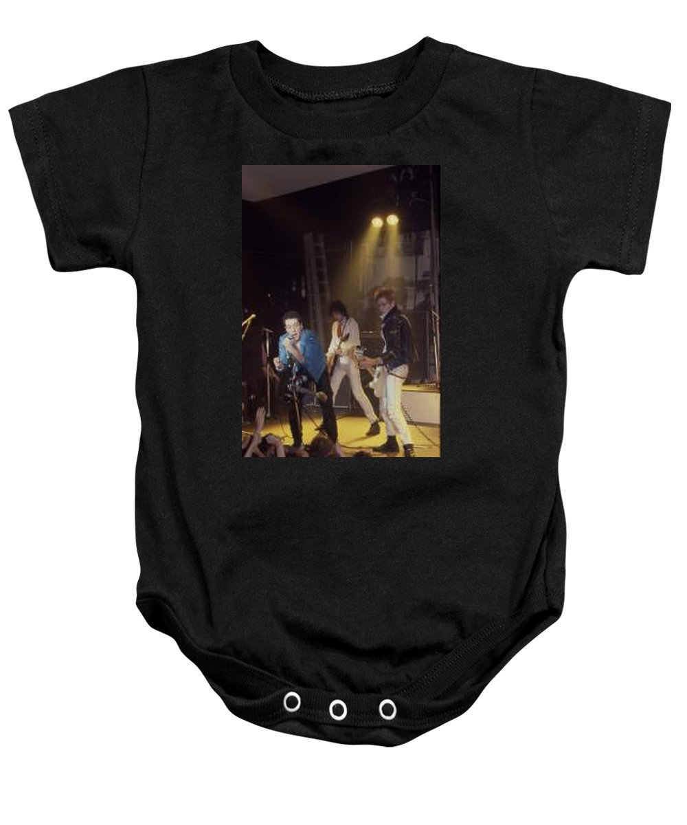 The Clash-london 1978 Photo By Dawn Wirth-copyrighted Baby Onesie featuring the photograph The Clash-london - July 1978 by Dawn Wirth