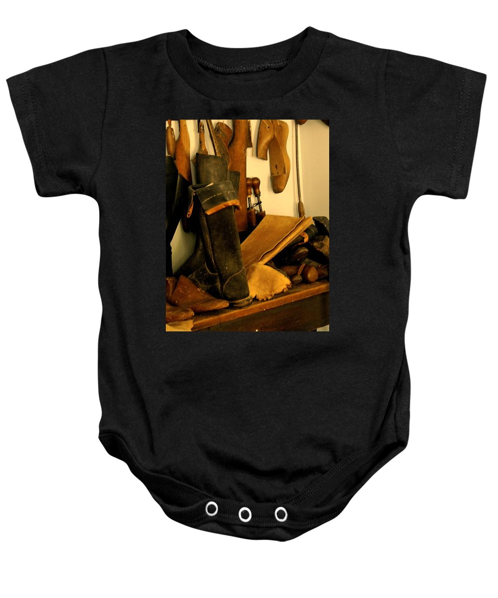 Shoess Baby Onesie featuring the photograph The Cobbler by Ian MacDonald