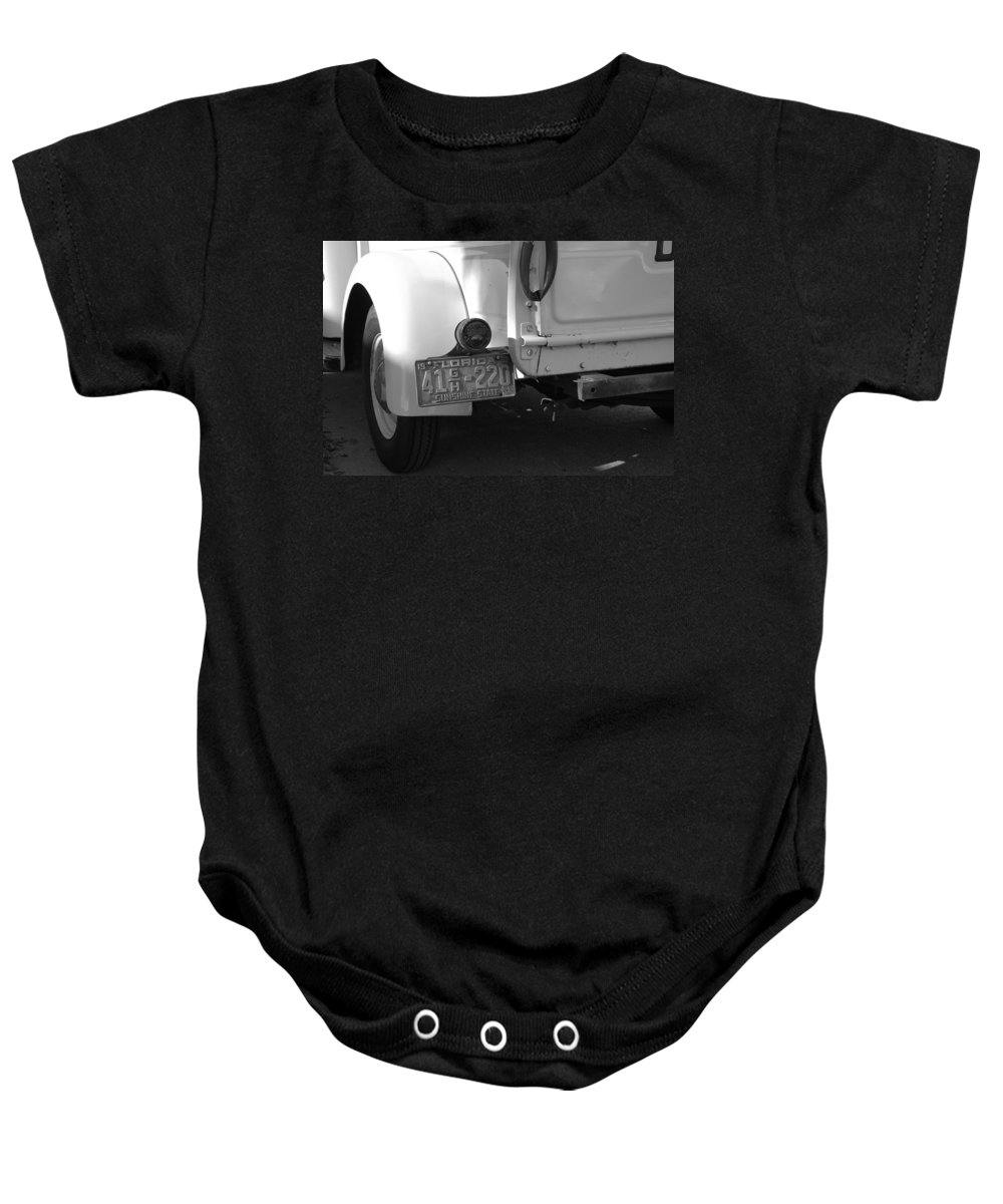 Black And White Baby Onesie featuring the photograph The Florida Dodge by Rob Hans