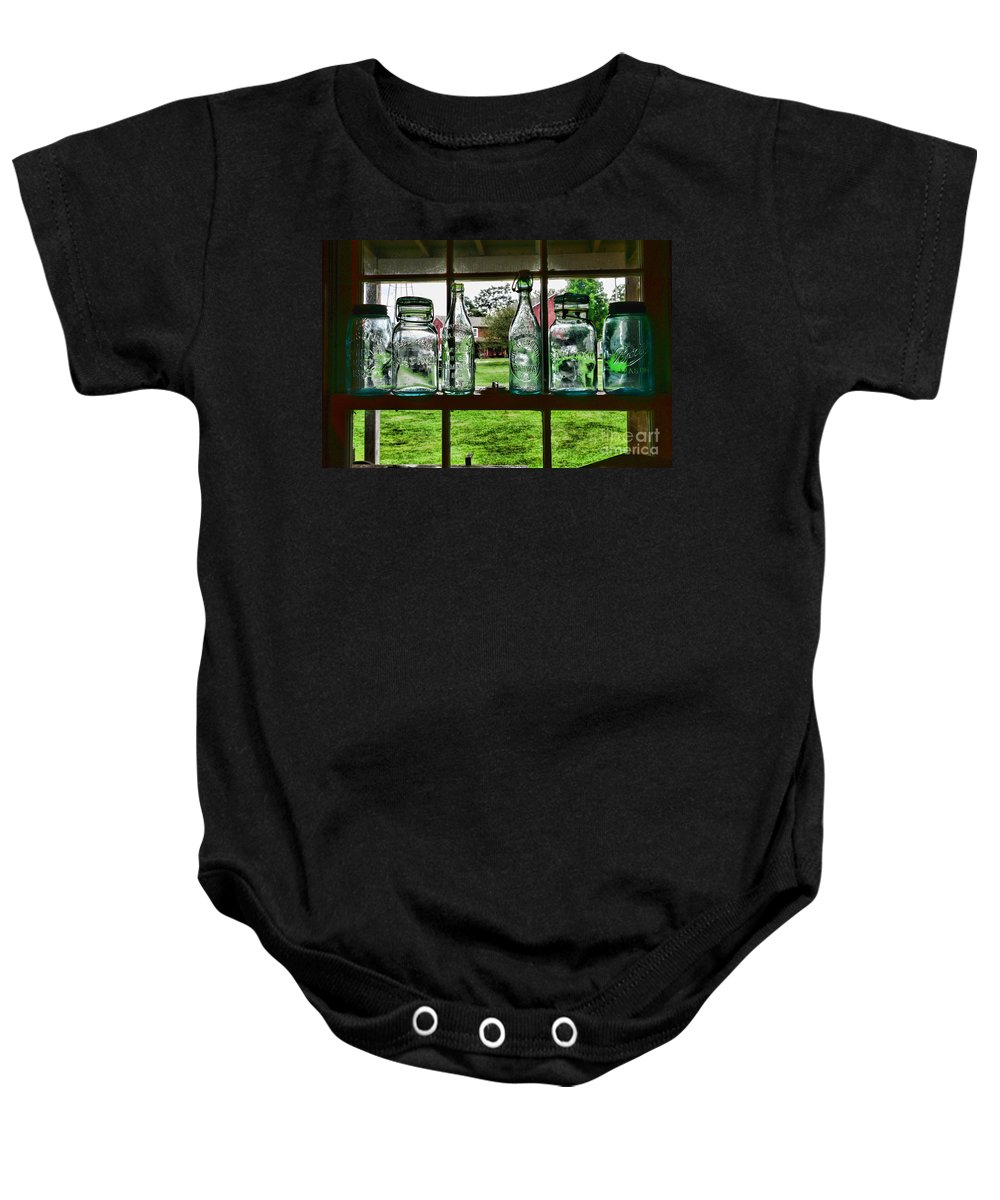 Bottles And Jars In The Window Baby Onesie featuring the photograph The Kitchen Window by Paul Ward