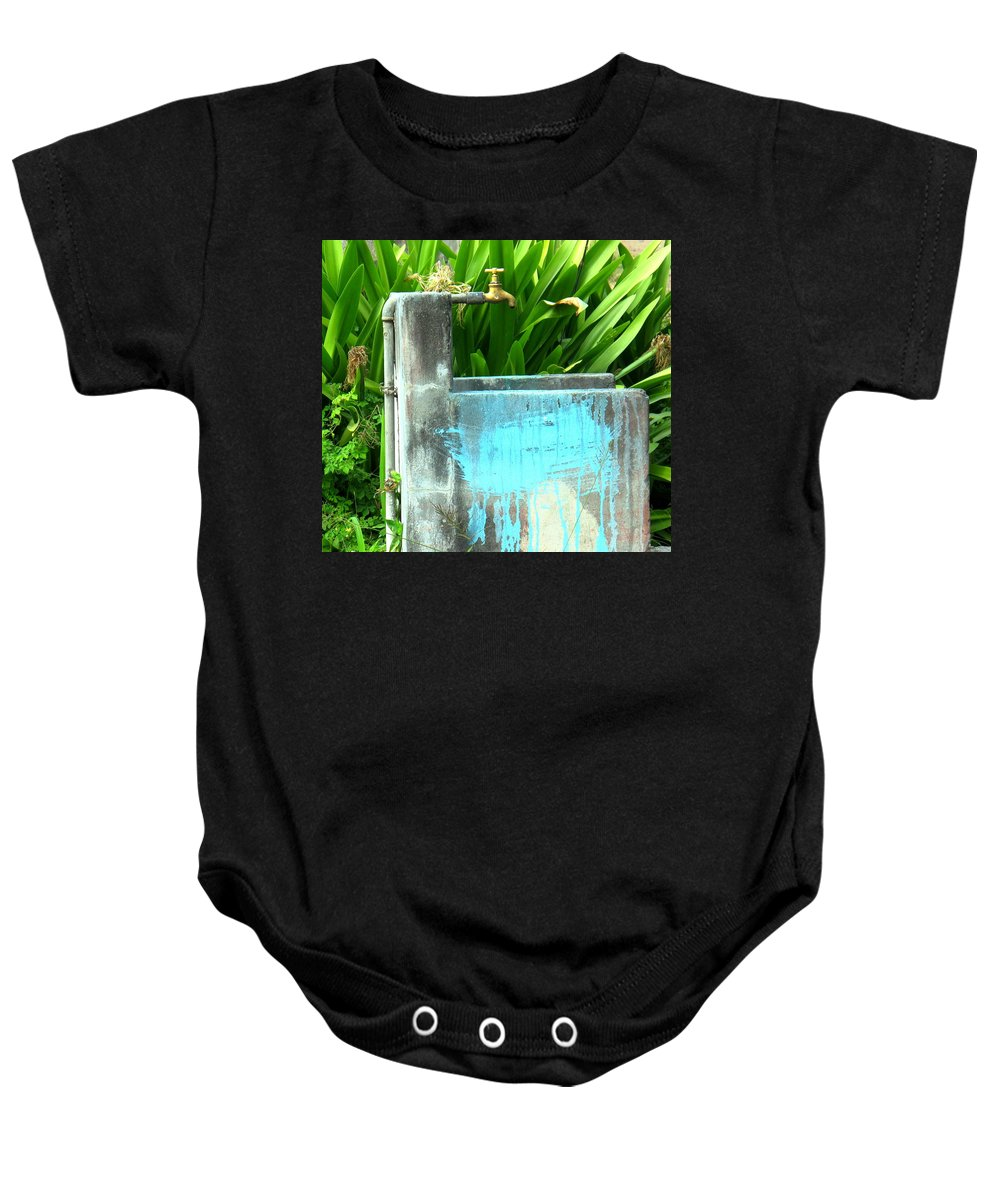 Water Baby Onesie featuring the photograph The Neighborhood Water Pipe by Ian MacDonald