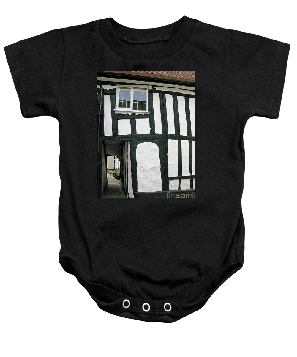 England Baby Onesie featuring the photograph There Was A Crooked Man by Ann Horn
