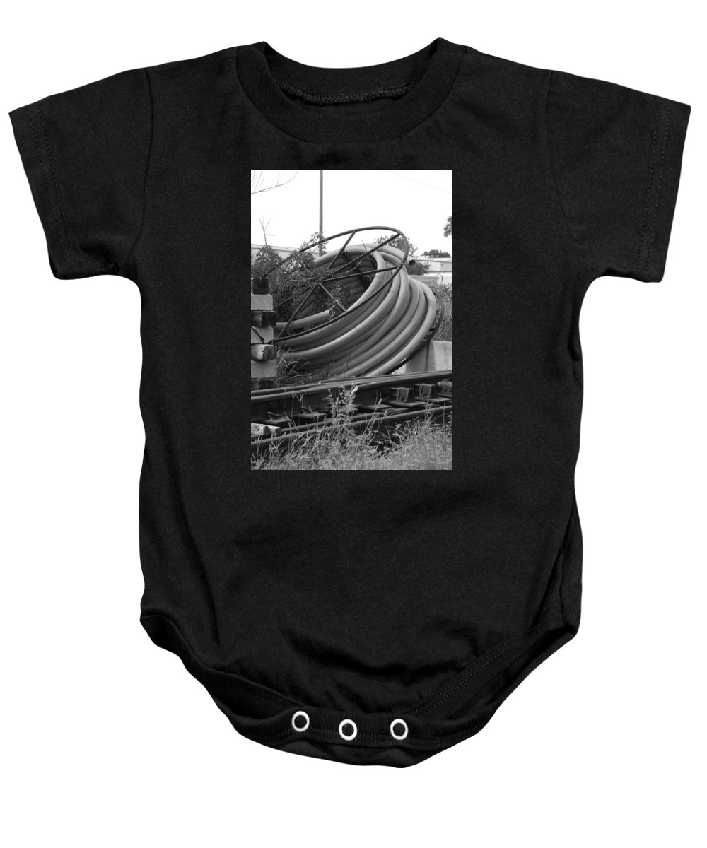 Blacka Nd White Baby Onesie featuring the photograph Tracks And Cable by Rob Hans