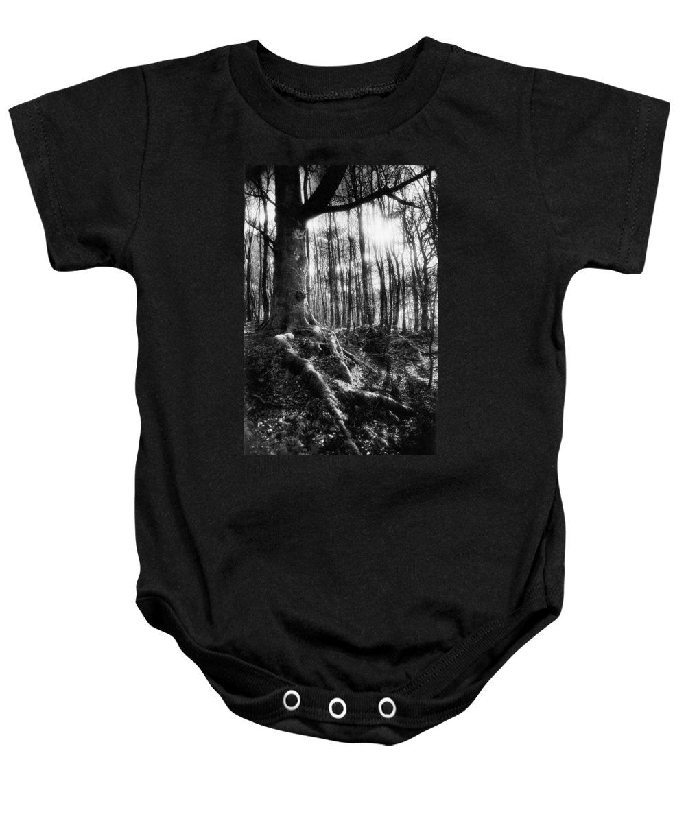 Vale; Legendary; Wood; Woods; Woodland; Landscape; Rural; Countryside; Magical; Mysterious; Fairytale; Bare Trees; Atmospheric; Dramatic; Eerie; Spooky; French; Moonlight; Moonlit Baby Onesie featuring the photograph Trees At The Entrance To The Valley Of No Return by Simon Marsden
