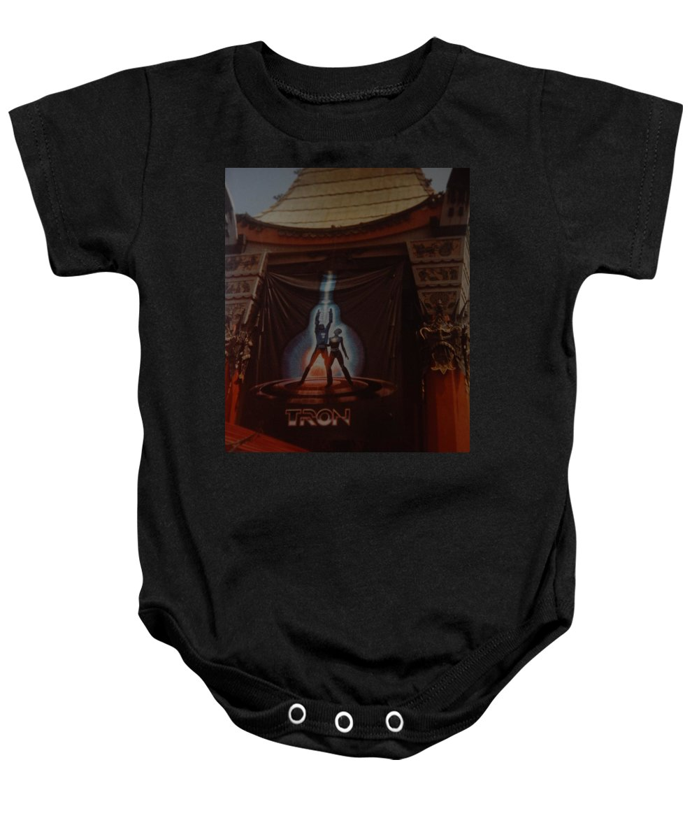 Grumanns Chinese Theater Baby Onesie featuring the photograph Tron by Rob Hans
