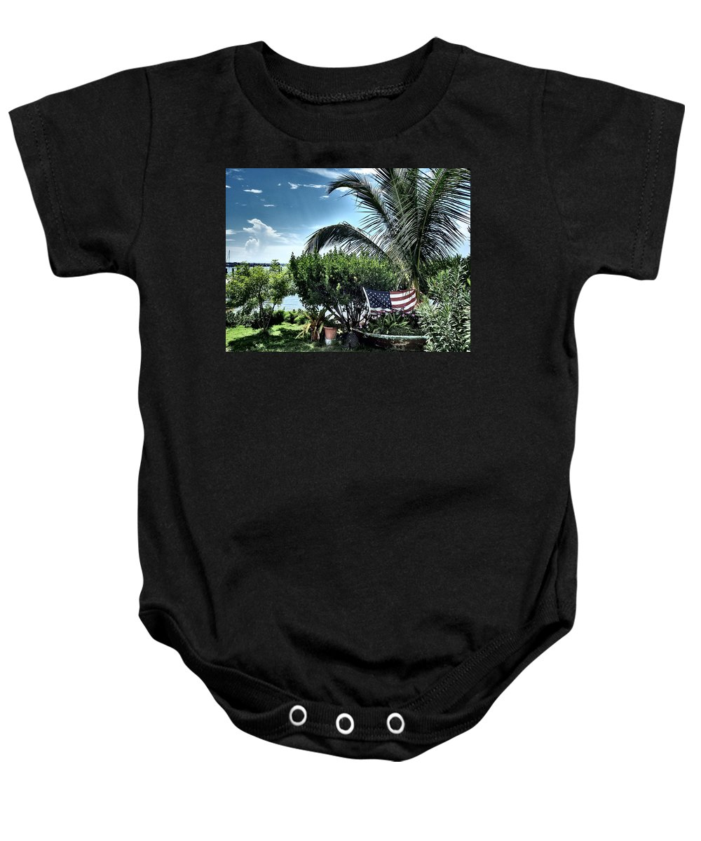 Amerian Flag Baby Onesie featuring the photograph US Flag in the Abaco Islands, Bahamas by Cindy Ross