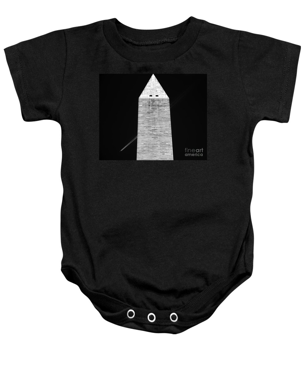 The Washington Monument Baby Onesie featuring the photograph Vapor Trail Behind Washington Memorial Bw by Tom Gari Gallery-Three-Photography