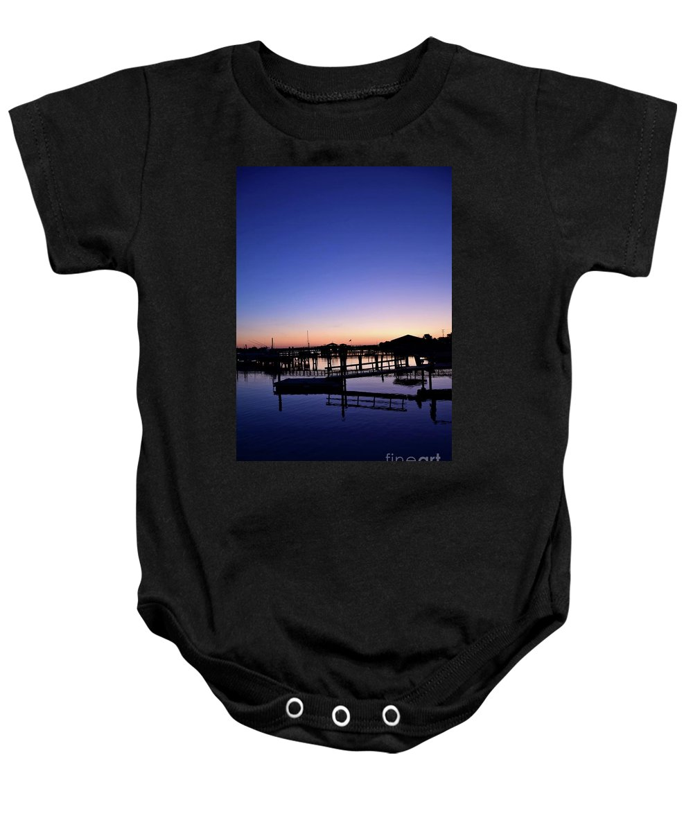 River; Marina; Boats; Docks; Pier; Grass; Orange; Blue; Flag; Warm; Breeze; Vacation; Blue Sky; Vibrant Colors; Sunny; Dawn; Sunrise; Sun; Sunshine; Ripples; Island; Solitude; Tranquil; Quiet; Relaxation; Soothing; Silence Baby Onesie featuring the photograph Vertical Pre-dawn Stillness At The Marina 13670 by Anna Gibson