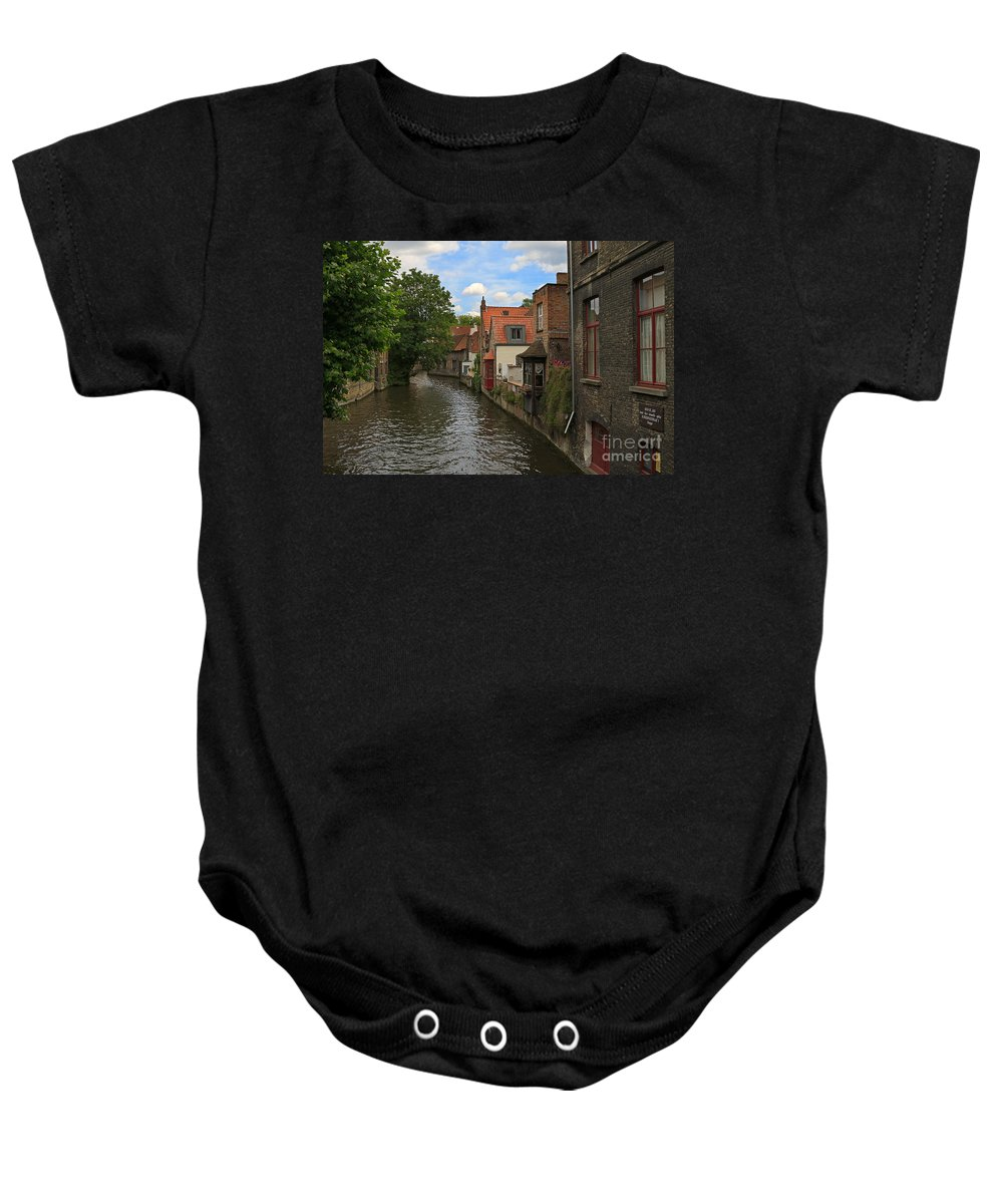 Canal Baby Onesie featuring the photograph View Of The Canal From Maria Brug On Katelijnestraat In Bruges by Louise Heusinkveld