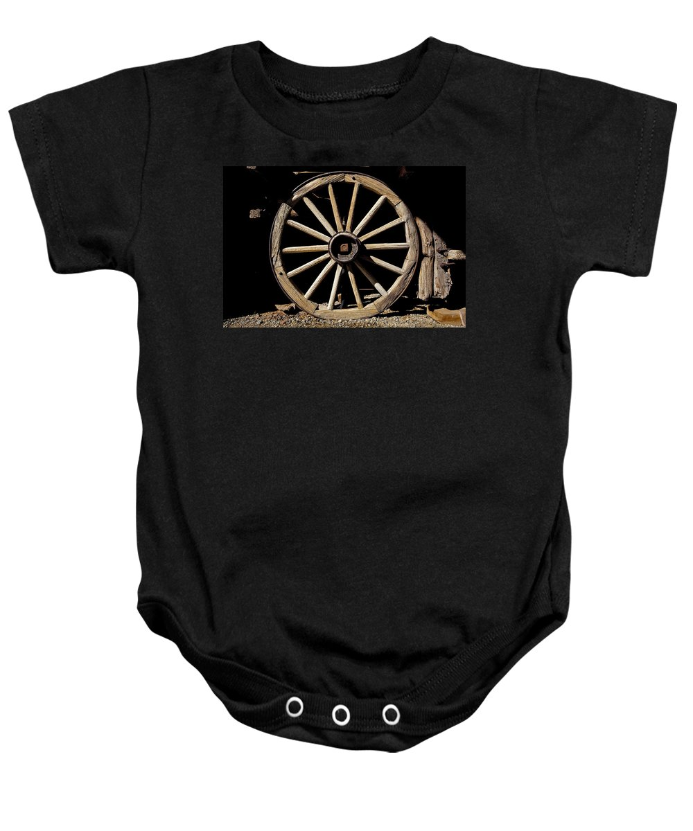 Wagon Wheel Baby Onesie featuring the photograph Wagon Wheel Texture by Kelley King