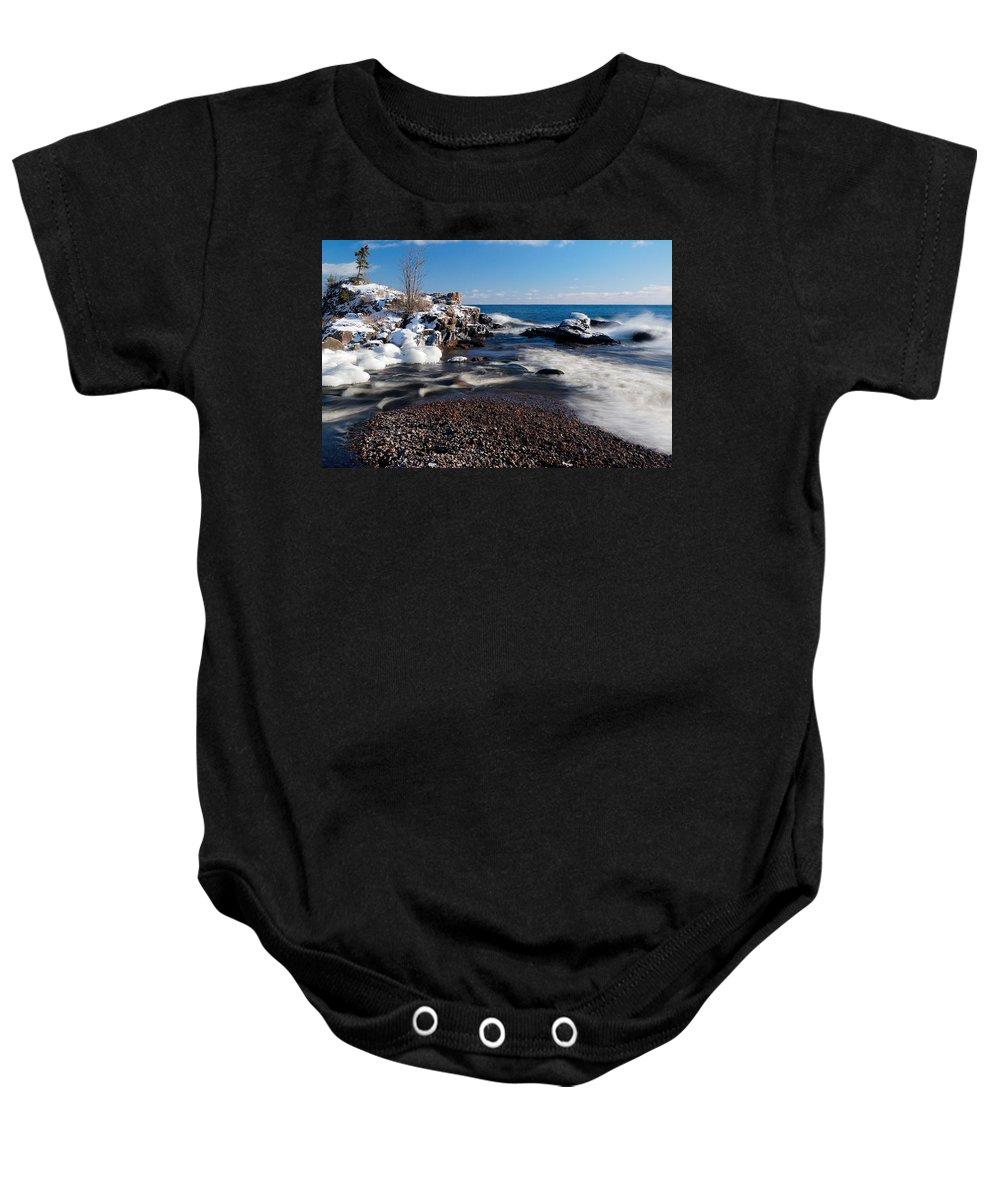 Michigan Baby Onesie featuring the photograph Winter Splash by Sebastian Musial