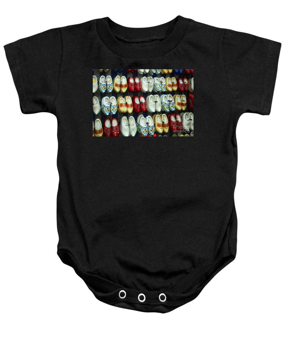 Timothy Hacker Baby Onesie featuring the photograph Wooden Shoes by Timothy Hacker
