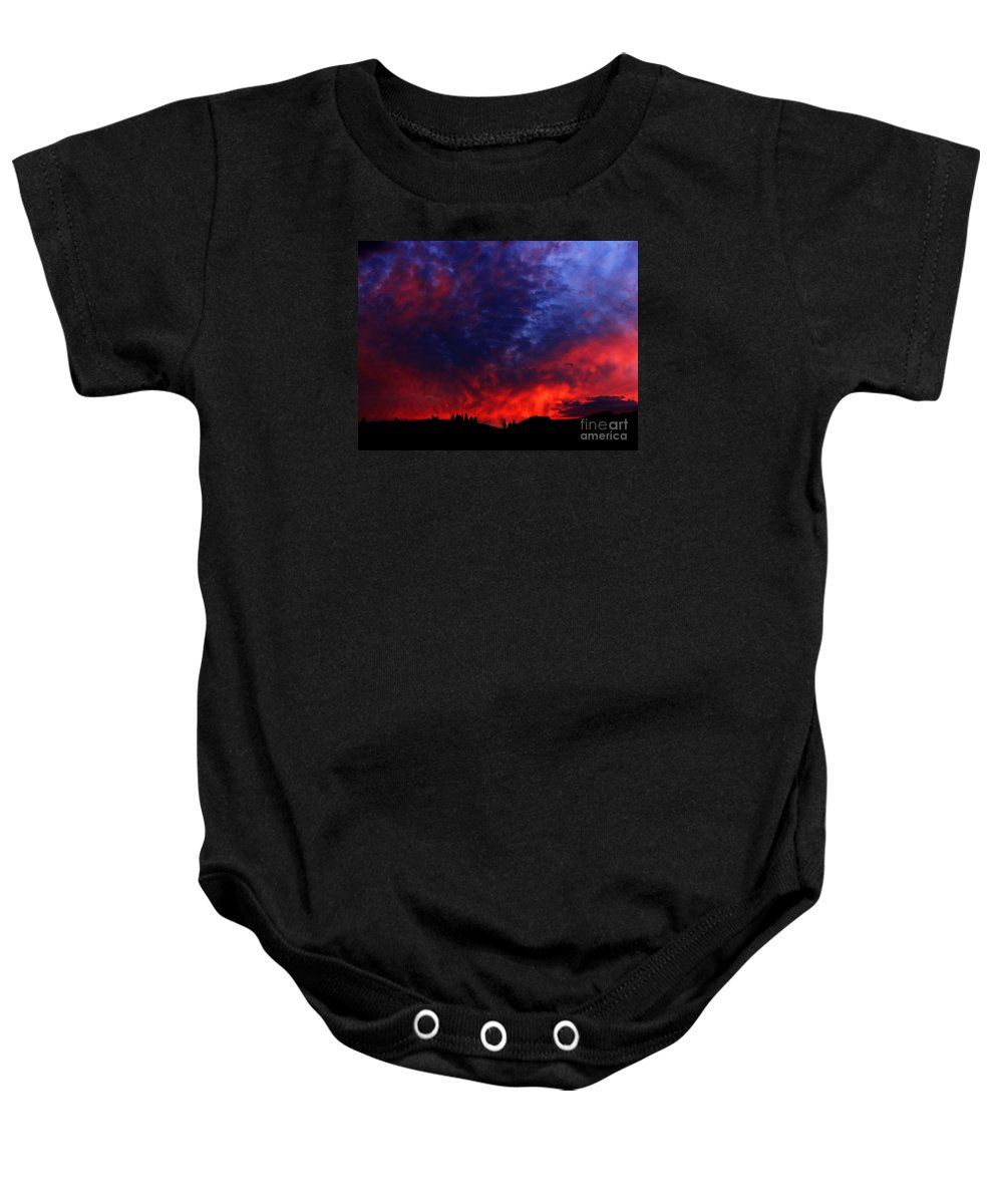 Wyoming Baby Onesie featuring the photograph Wyoming Sunset On Fire by Ron Tackett