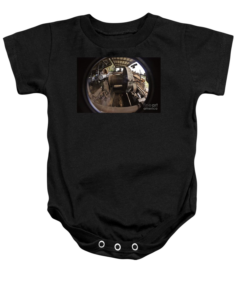 Clay Baby Onesie featuring the photograph Ye Olde Logging Camp by Clayton Bruster