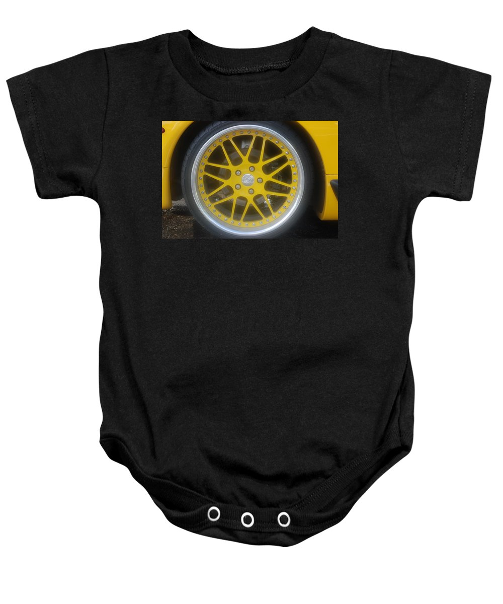Corvette Baby Onesie featuring the photograph Yellow Vette Wheel by Rob Hans