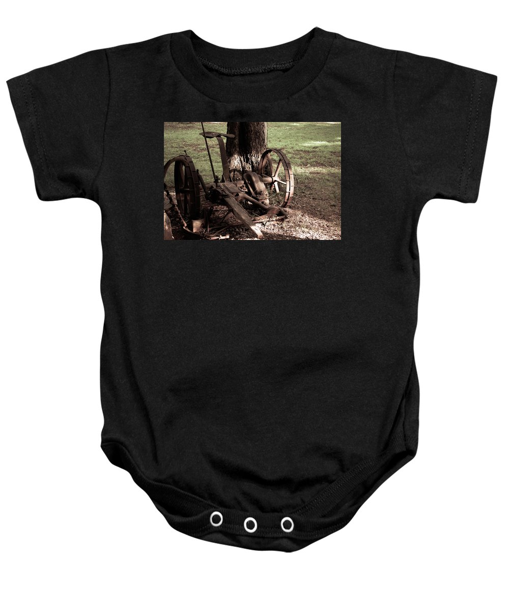 Rust Baby Onesie featuring the photograph Riding In Style by Leslie and Mitch Anderson