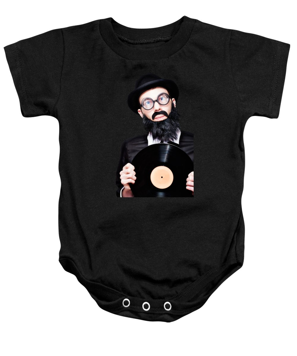 Records Baby Onesie featuring the photograph Sixties Retro Rock Man Holding Music Record Vinyl by Jorgo Photography - Wall Art Gallery