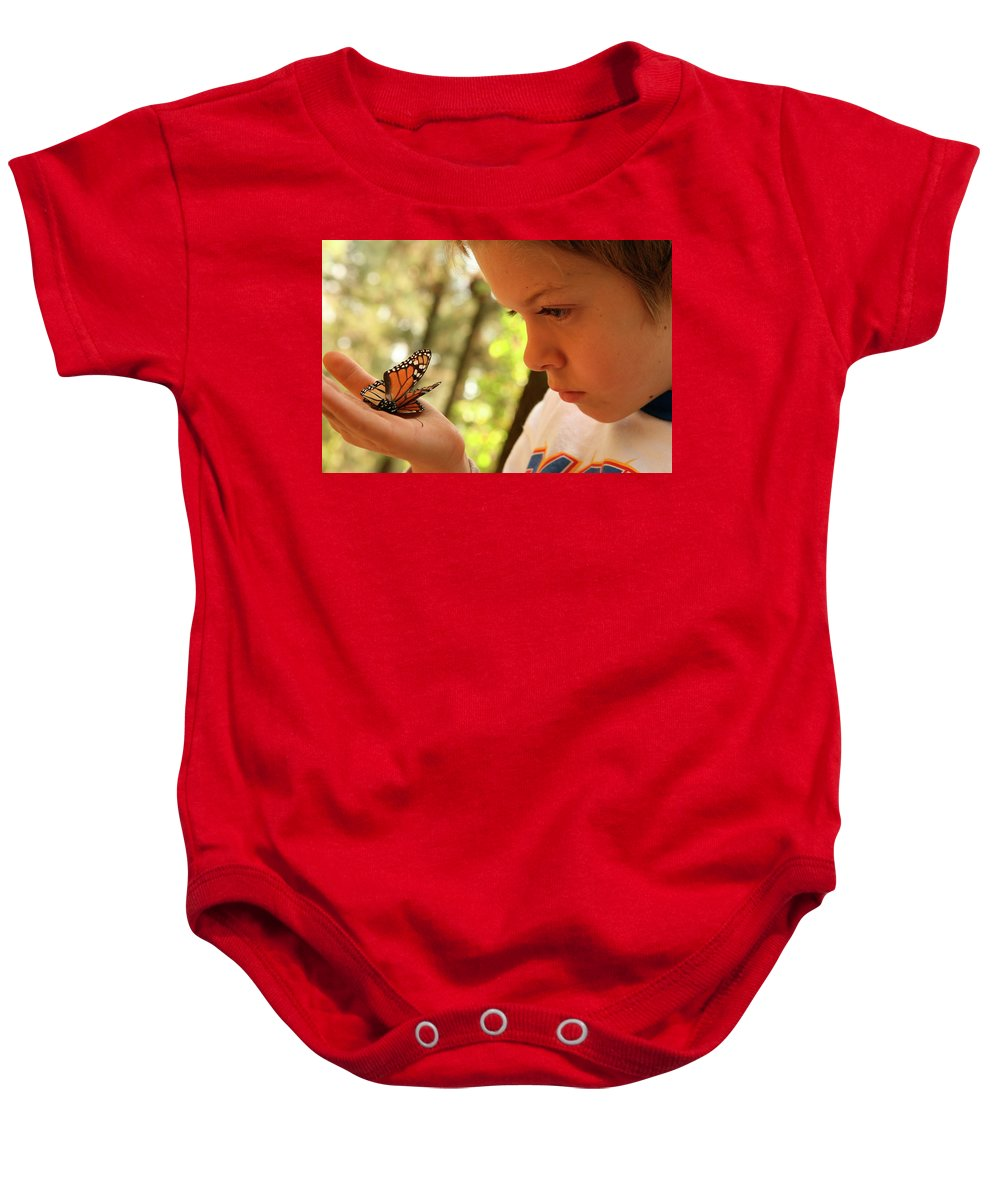 Angangueo Baby Onesie featuring the photograph A Young Boy Holds A Stick by Robb Kendrick