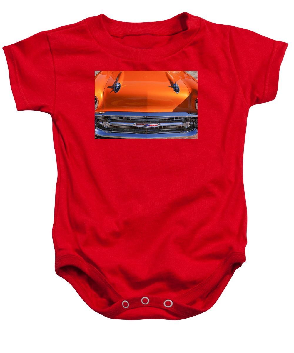1957 Chevrolet Bel Air Hood Ornament Baby Onesie featuring the photograph 1957 Chevrolet Belair Hood Ornament - Grille Emblem -055c by Jill Reger