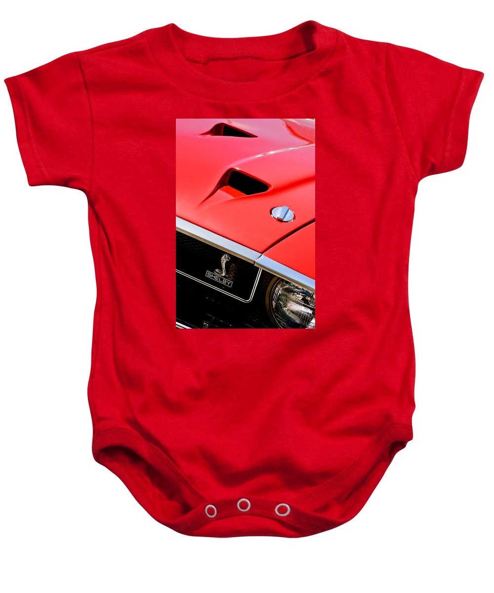 1969 Shelby Gt500 Convertible 428 Cobra Jet Hood - Grille Emblem Baby Onesie featuring the photograph 1969 Shelby Gt500 Convertible 428 Cobra Jet Hood - Grille Emblem by Jill Reger