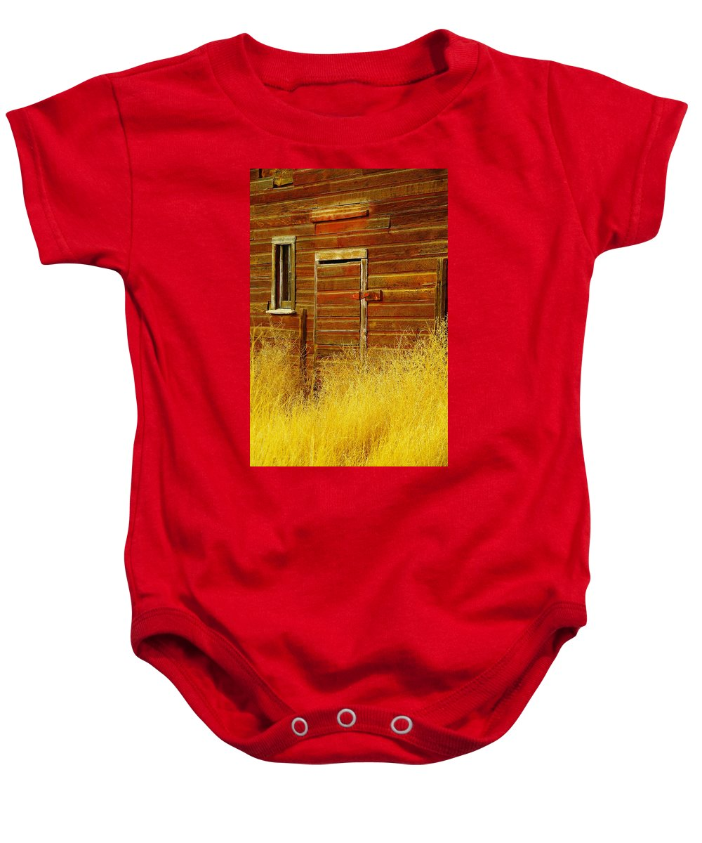 Barns Baby Onesie featuring the photograph An Old Barn Door by Jeff Swan