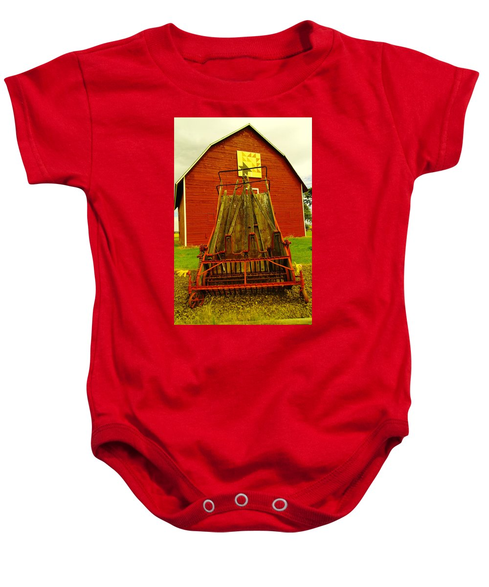 Wagons Baby Onesie featuring the photograph An Old Barn In Kittitas by Jeff Swan