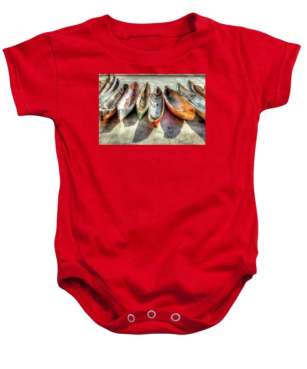 The Baby Onesie featuring the photograph Canoes by Debra and Dave Vanderlaan