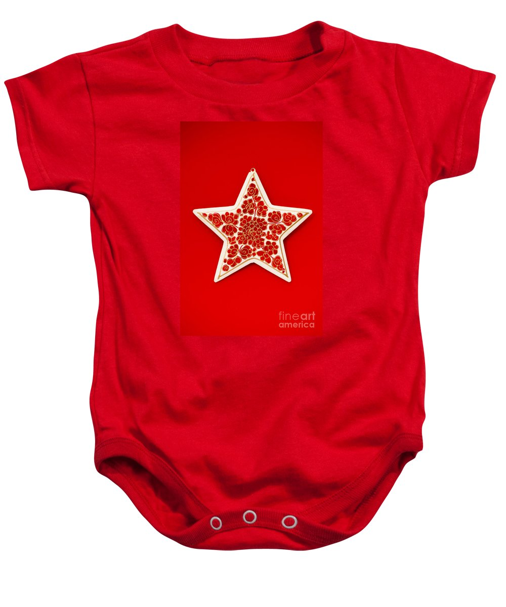 Background Baby Onesie featuring the photograph Festive Star by Anne Gilbert