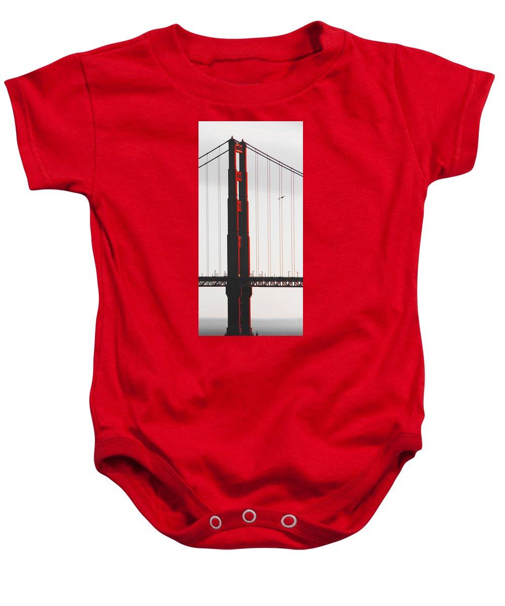 Golden Gate Baby Onesie featuring the photograph Golden Gate Bridge - Sunset With Bird by Ben and Raisa Gertsberg