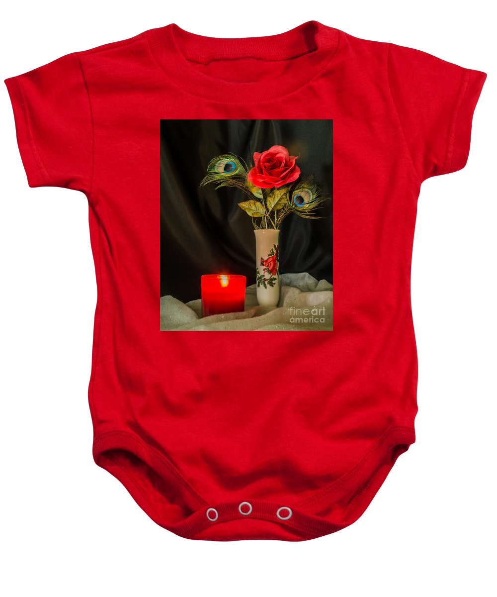 Still Life Baby Onesie featuring the photograph One Red Christmas Rose by Donna Brown