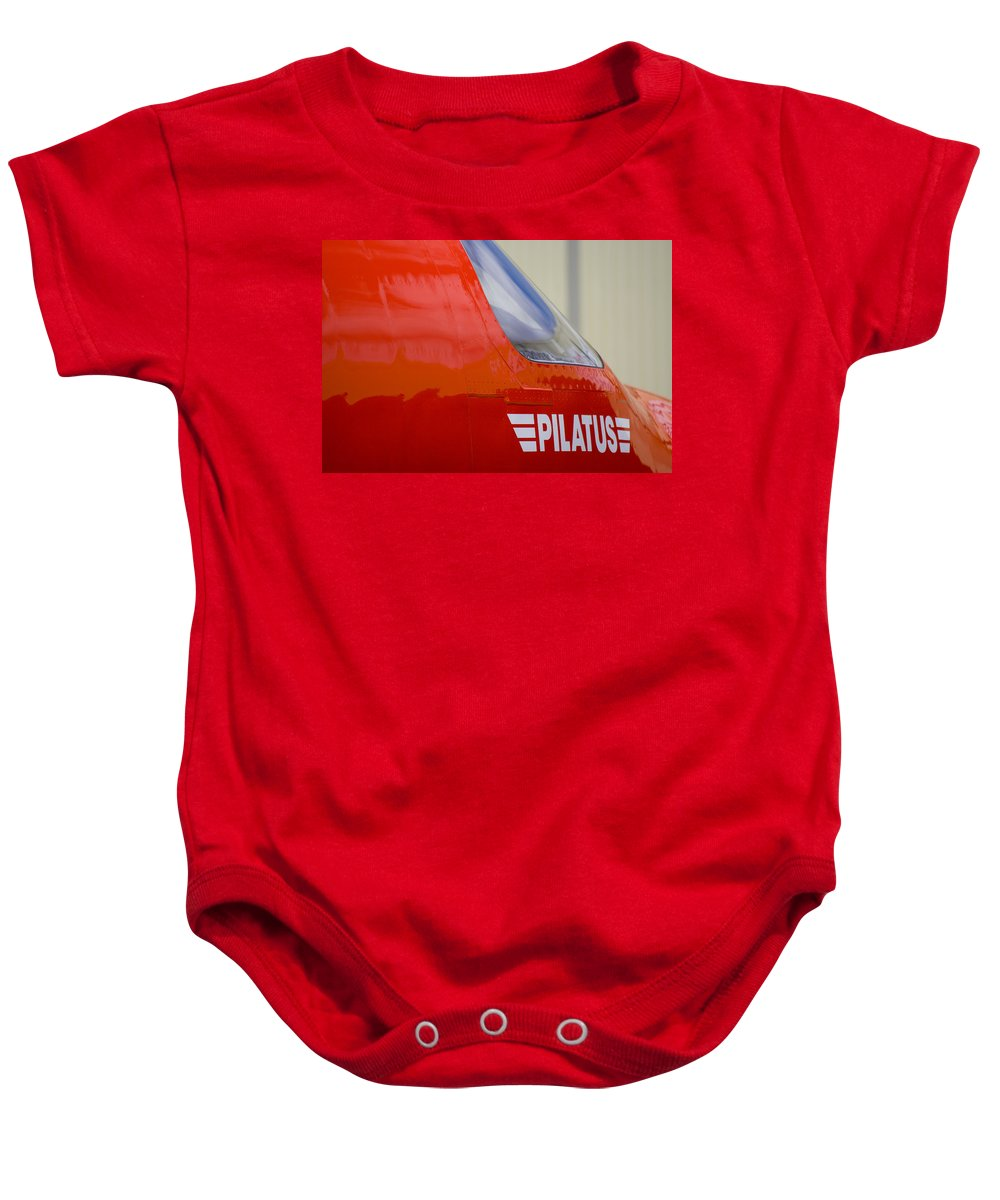 Pilatus Pc 12 Baby Onesie featuring the photograph Pilatus by Paul Job