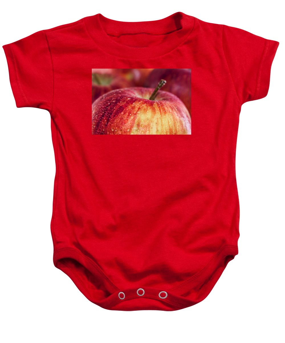 Red Baby Onesie featuring the photograph Red Apple by Paulo Goncalves