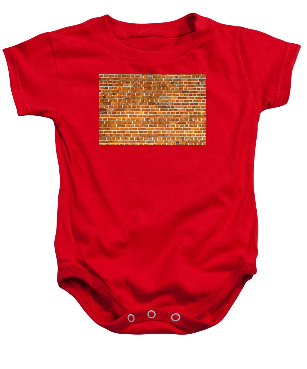 Red Baby Onesie featuring the photograph Red Brick Wall Texture by Antony McAulay