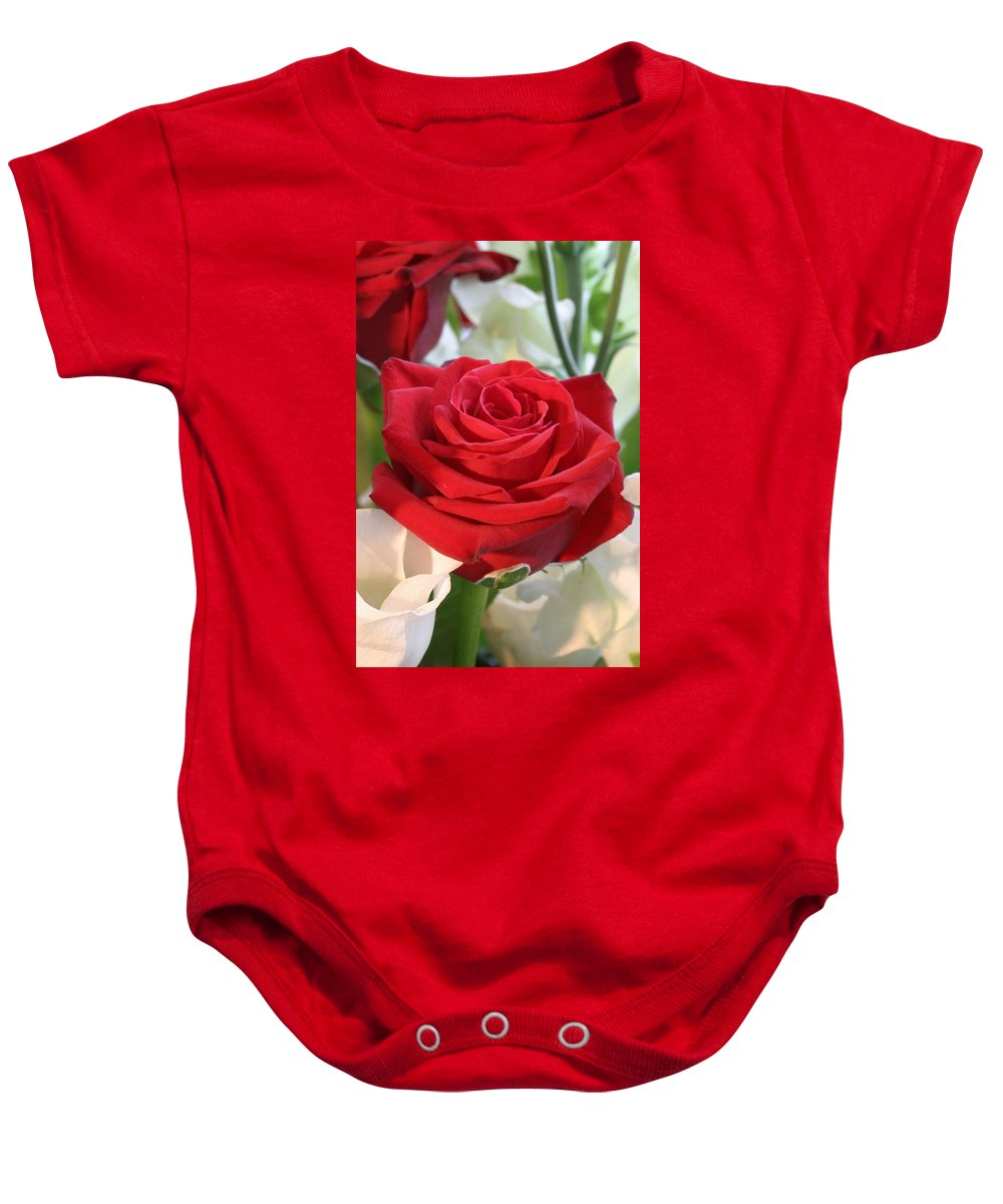 Rose Baby Onesie featuring the photograph Red Rose With Garden Background by Taiche Acrylic Art