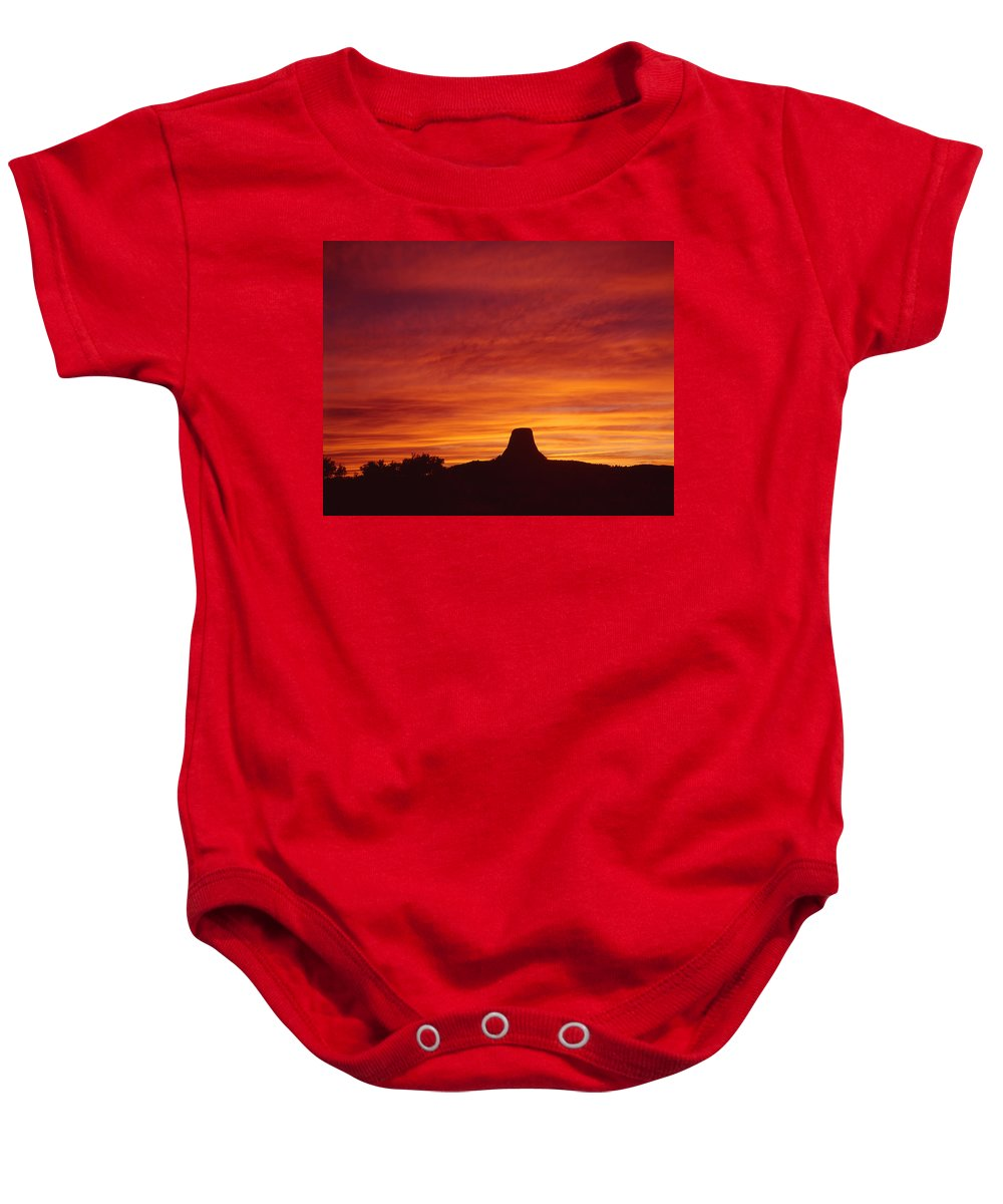 Sunset Baby Onesie featuring the photograph Sunset Behind Devil's Tower by Ed Cooper Photography