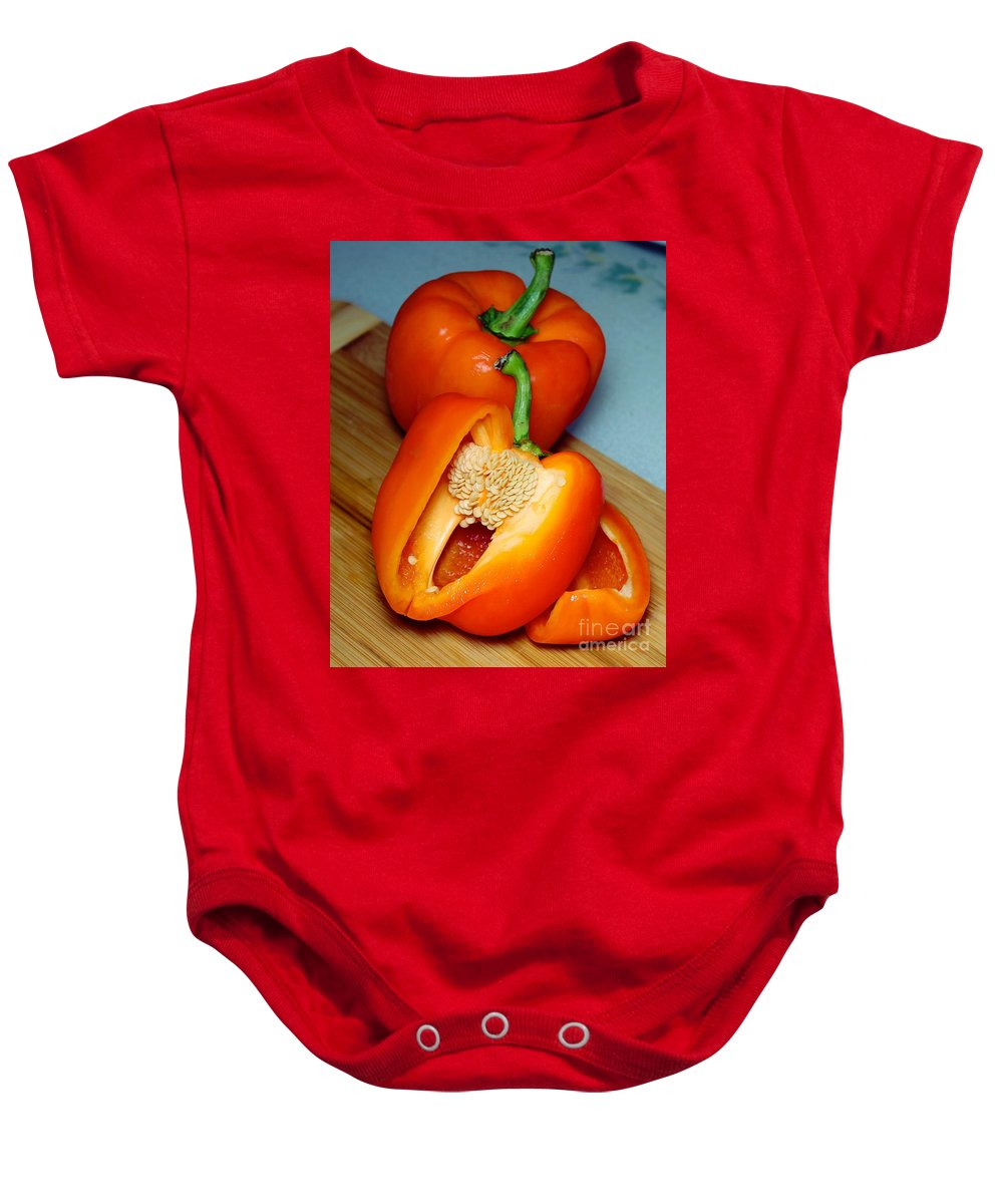Sweet Orange Peppers On Bamboo Cutting Board Baby Onesie featuring the photograph Sweet Orange Peppers On Bamboo Cutting Board by Barbara Griffin