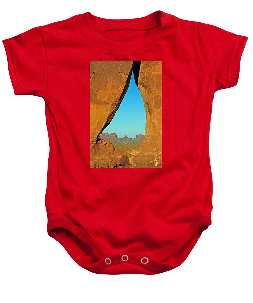 Monument Valley Baby Onesie featuring the photograph Tear Drop Arch Monument Valley by Jeff Brunton