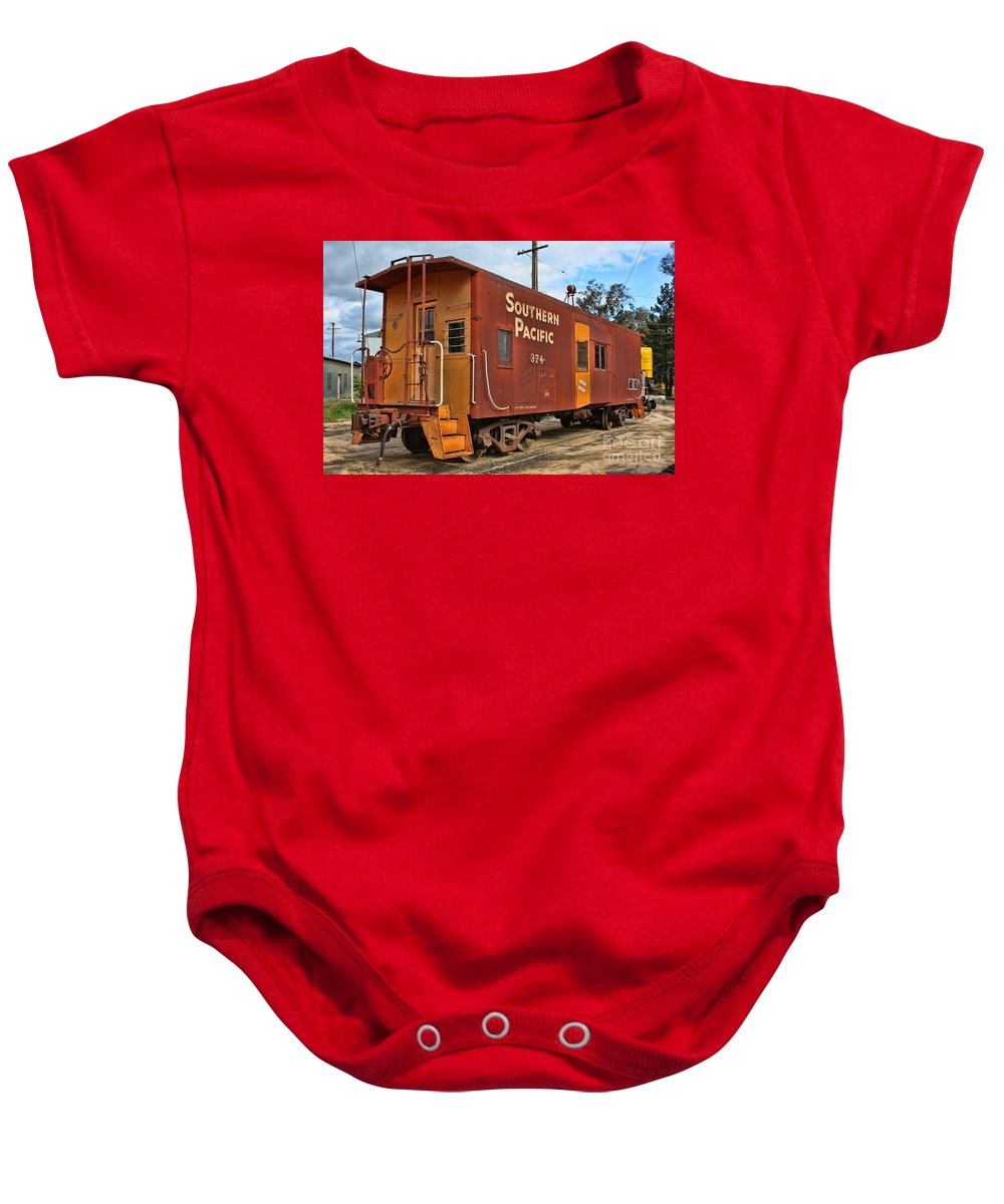 Railroad Baby Onesie featuring the photograph The Caboose by Tommy Anderson