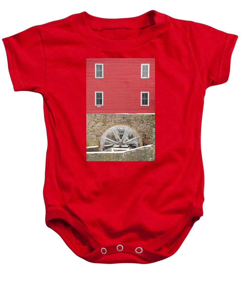 Mill Baby Onesie featuring the photograph The Frozen Wheel by Mark Robert Rogers