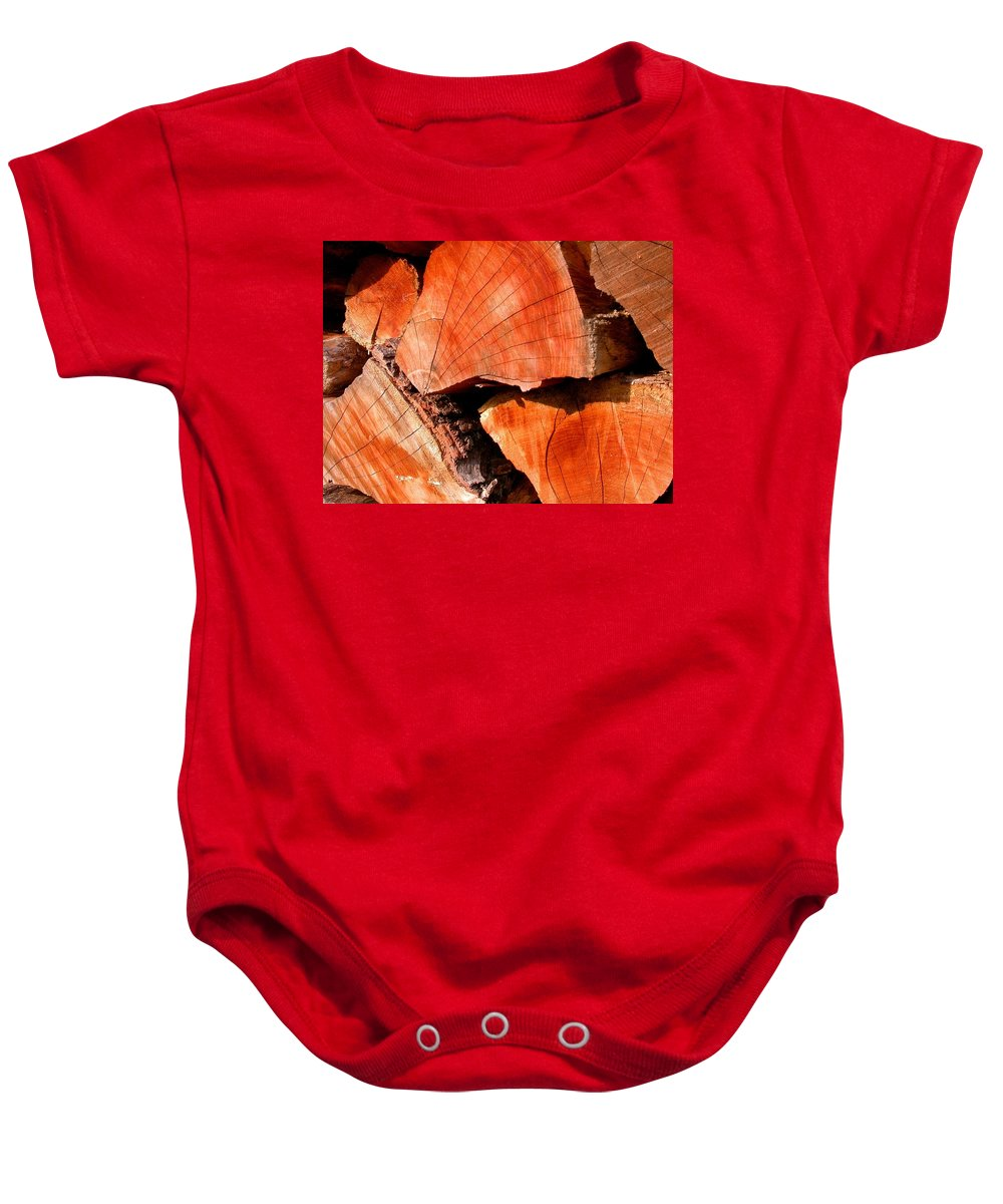 Woodpile Baby Onesie featuring the photograph Woodstock by Cynthia Wallentine