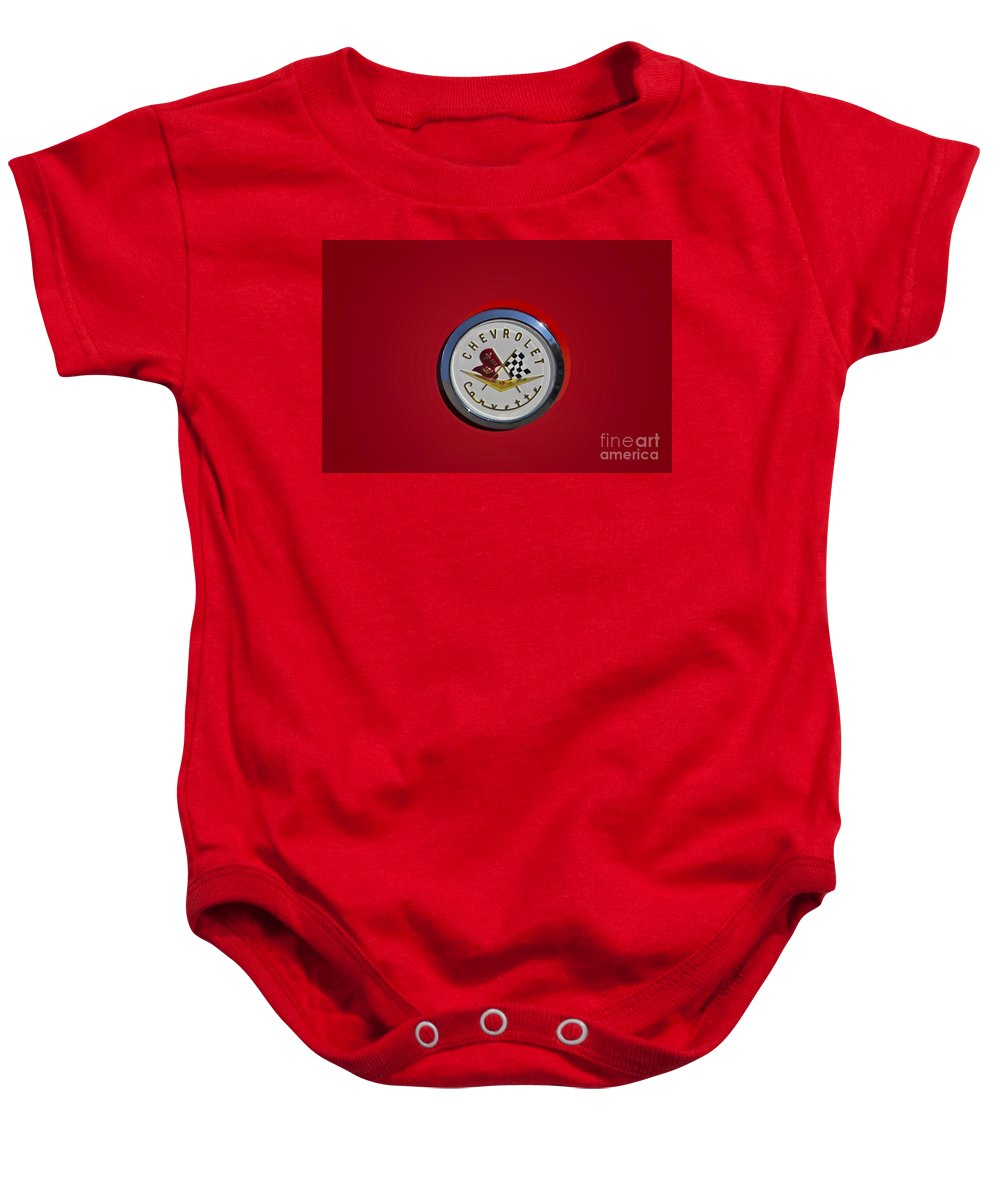 1957 Baby Onesie featuring the photograph 1957 Red Corvette Emblem by Susan Candelario